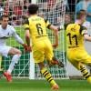 Reus helps Dortmund keep heat on Bayern with Freiburg win