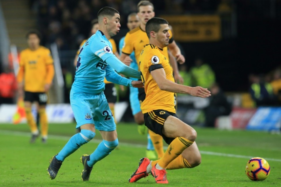 Newcastle\'s Miguel Almiron challenges Wolves\' Conor Coady