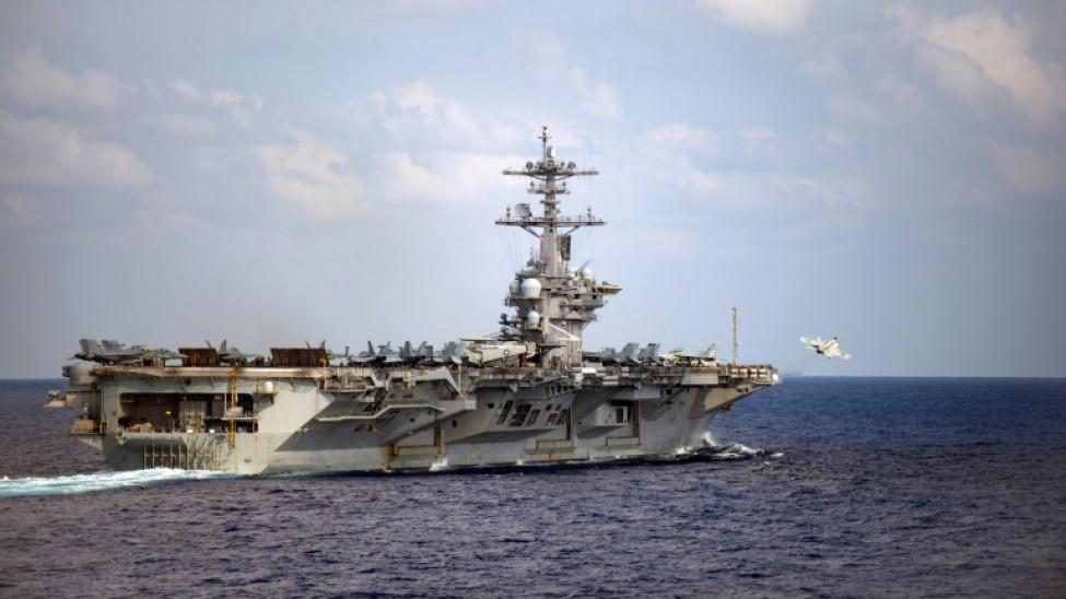 Photo d\'archive obtenue le 31 mars 2020 de l\'US du porte-avion américain USS Theodore Roosevelt (CVN 71), croisant le 18 mars 2020 dans l\'océan Pacifique.