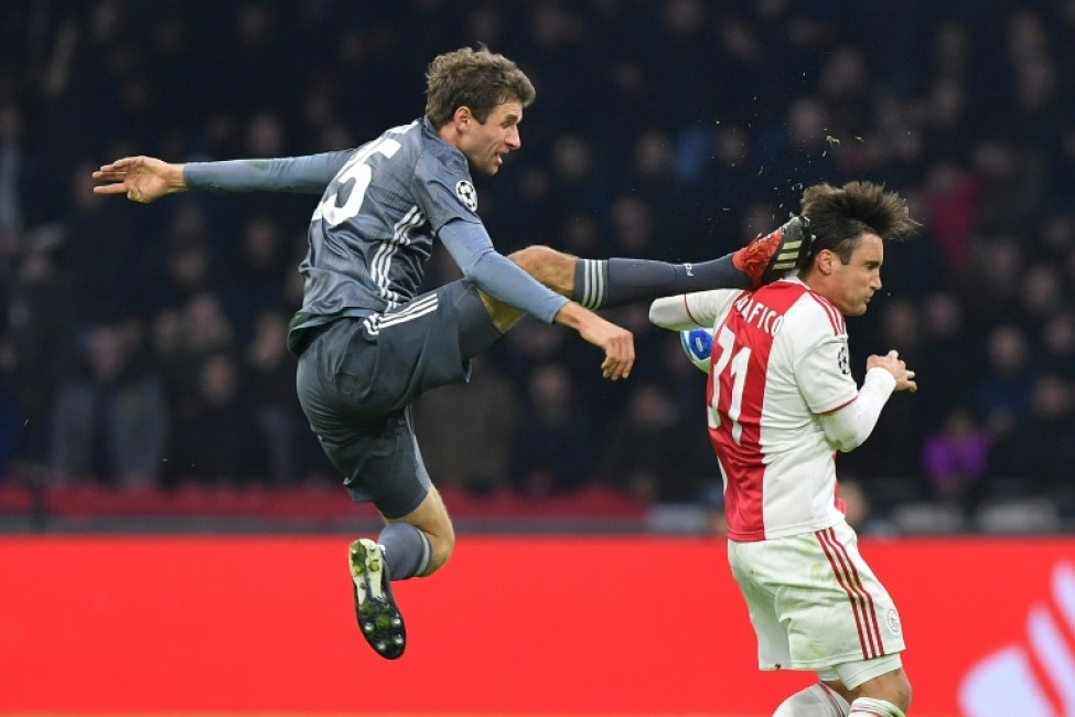 Bayern Munich striker Thomas Mueller is suspended for both legs of their Champions League last 16 matches against Liverpool for this kick on Ajax\'s Argentine defender Nicolas Tagliafico during December\'s 3-3 draw in Amsterdam in the group stages.