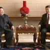 Capture d\'écran de la télévision chinoise CCTV du président chinois Xi Jinping (d) et du leader nord-coréen Kim Jong Un, le 9 janvier 2019 à Pékin