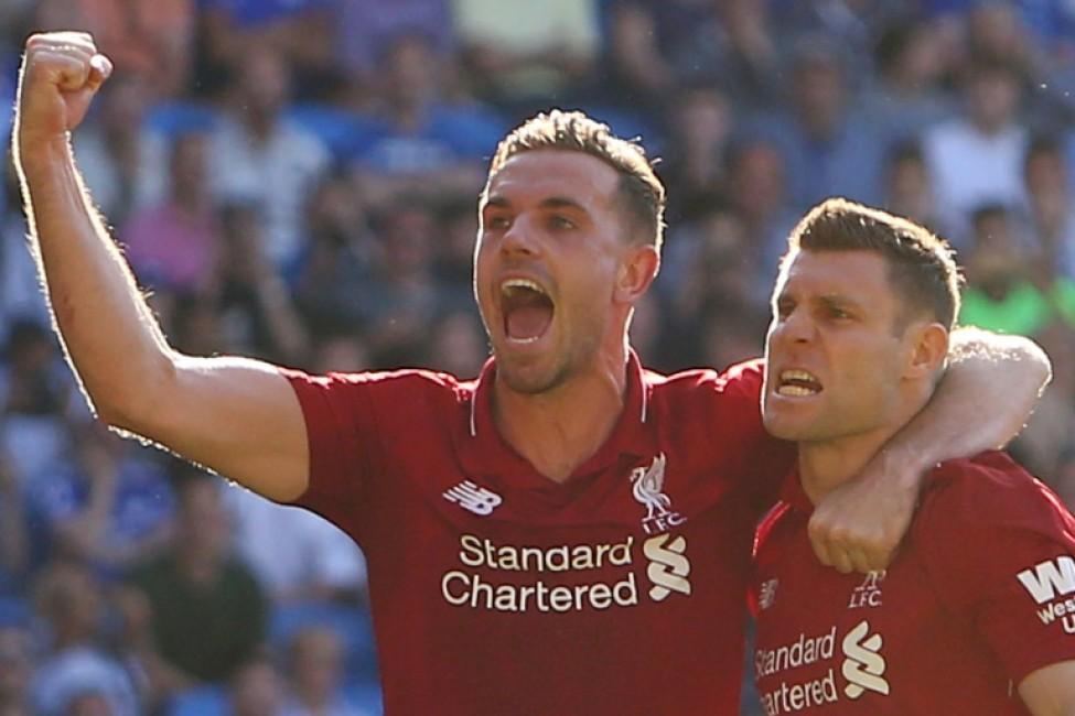 James Milner celebrates scoring Liverpool\'s second goal against Cardiff