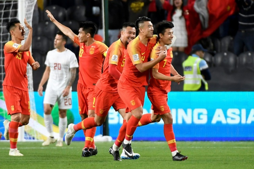 Lei Wu celebreates scoring one of his two goals in China\'s Asian Cup win over the Philippines