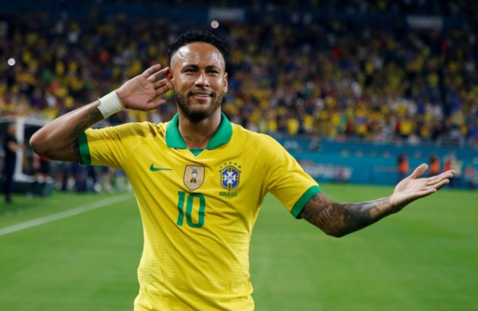 A woman who accused Brazilian football star Neymar -- seen here celebrating after scoring against Colombia during their international friendly football match in Miami, Florida on September 6, 2019 -- of rape is facing extortion and slander charges