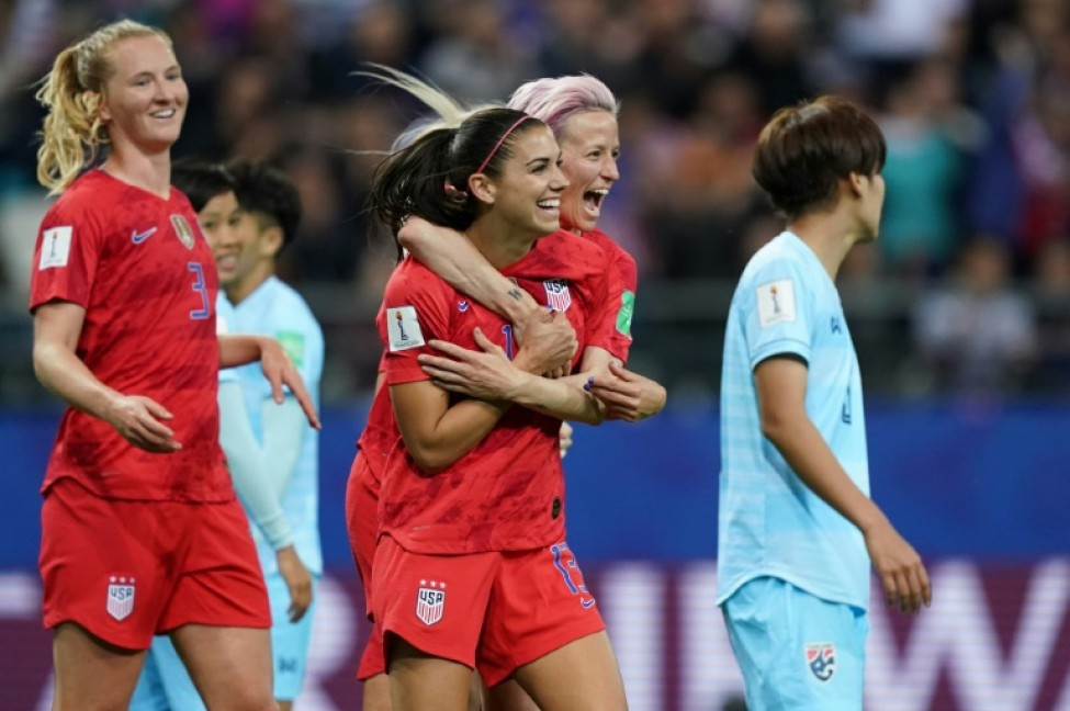 Alex Morgan (2nd right) celebrated her five-goal haul with Megan Rapinoe