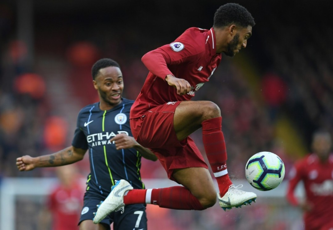 Liverpool defender Joe Gomez (right) faces a lengthy spell on the sidelines after a leg fracture