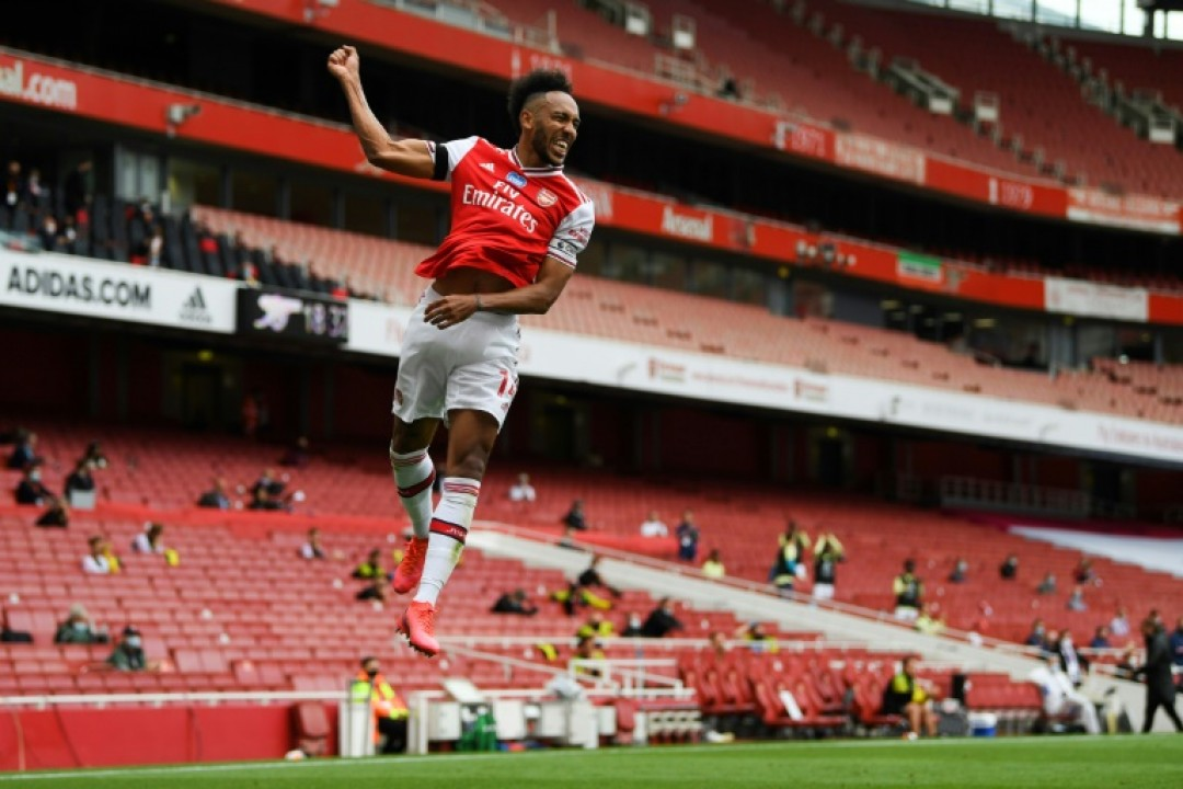 Arsenal striker Pierre-Emerick Aubameyang celebrates after scoring against Norwich