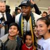 Bolt arrives in Australia on football quest