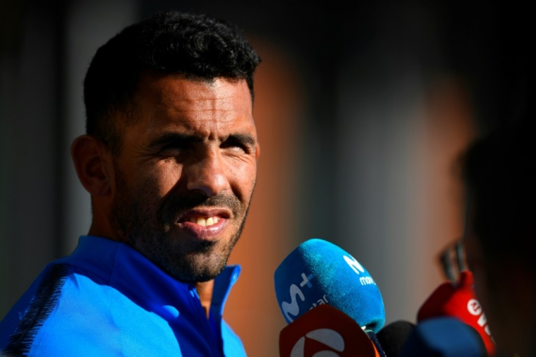 Boca Juniors star Carlos Tevez talks to media at the Spanish Football Federation (RFEF) headquarters in Madrid, ahead of Sunday\'s Libertadores Cup final against Buenos Aires rivals River Plate.