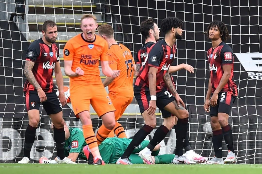 Sean Longstaff (centre) celebrates Newcastle\'s second goal against Bournemouth