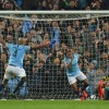 The goal that wasn\'t: Turkish referee Cuneyt Cakir looks on as Manchester City\'s Raheem Sterling celebrates scoring -- but the injury-time goal was ruled out by VAR for offside