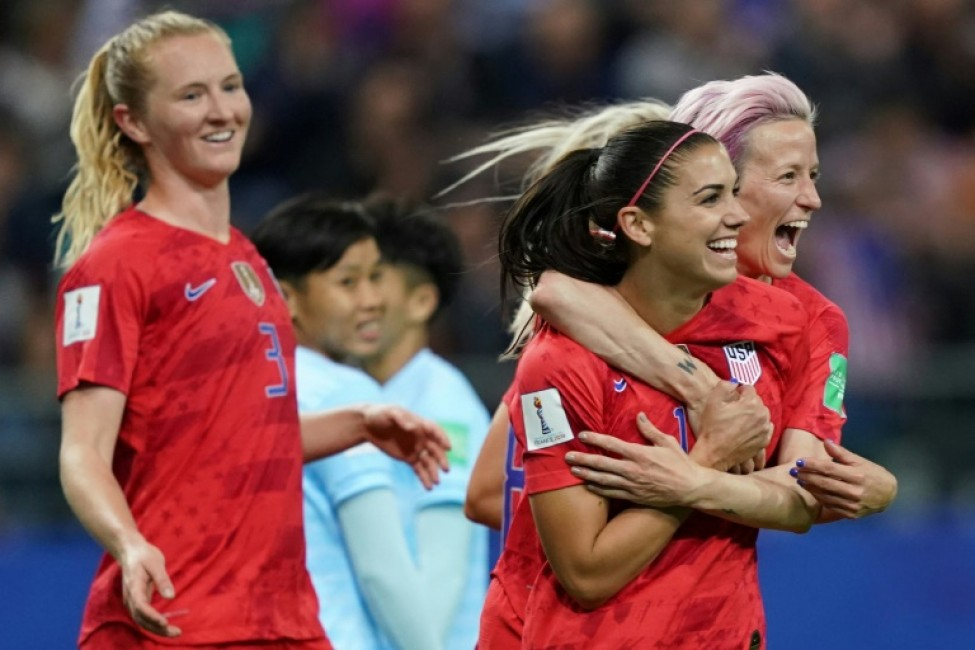 Alex Morgan (2R) celebrates with her teammates after scoring one of her five goals in the USA\'s record-breaking 13-0 hammering of Thailand