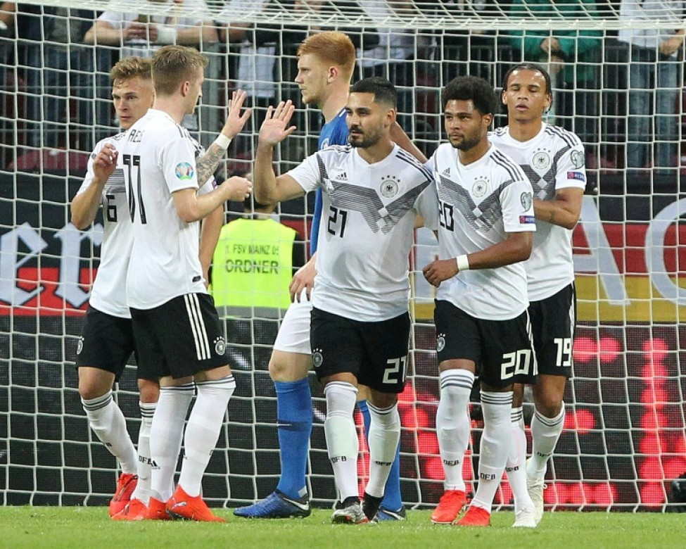 Ilkay Gundogan scored a penalty and created two other goals in Germany\'s 8-0 thrashing of Estonia on Tuesday