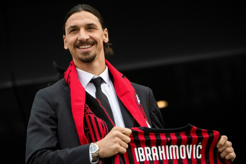 Swedish forward Zlatan Ibrahimovic poses with his new jersey during his official presentation with AC Milan.