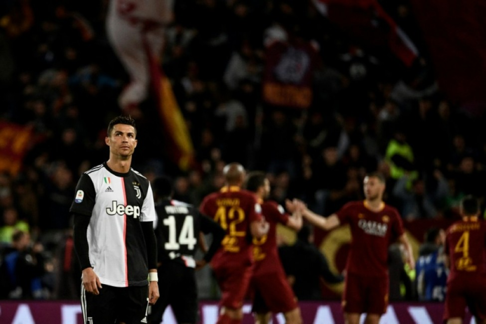 7b39b0598 Cristiano Ronaldo had a goal ruled out for offside as Roma inflicted a  third defeat this