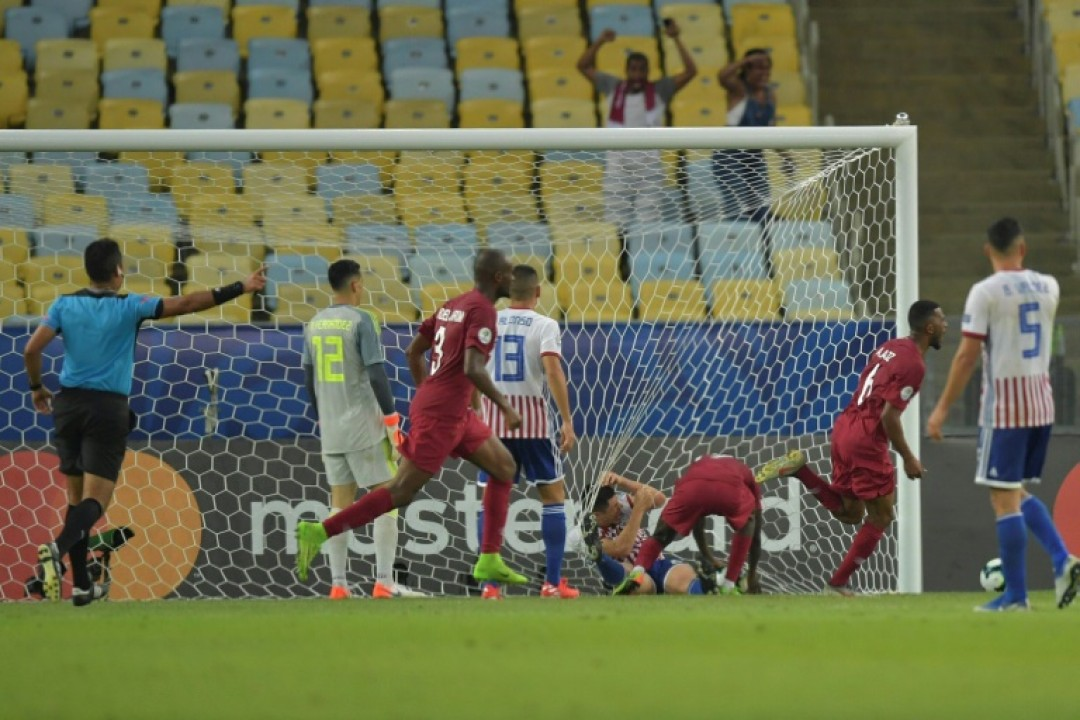 Qatar\'s players celebrate after Boualem Khoukhi scores the equalizer in their 2-2 Copa America draw with Paraguay