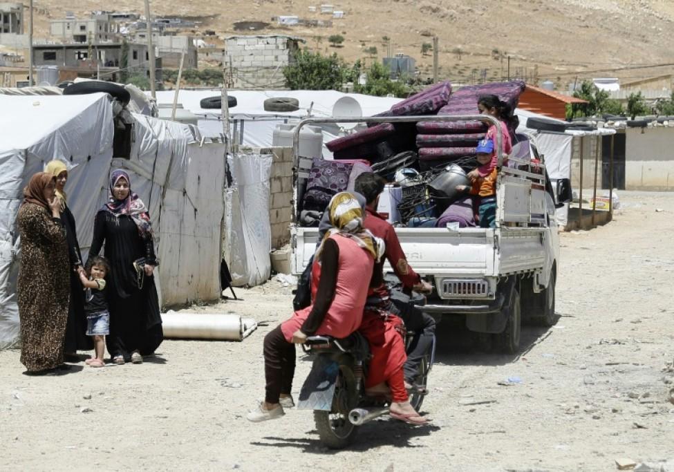 Des réfugiés syriens quittent un camp à Arsal, dans le nord-est du Liban, le 10 juin 2019