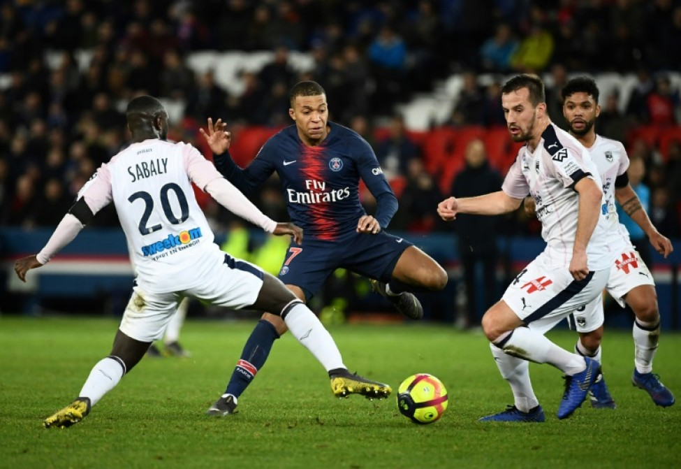 The absence of Neymar and Edison Cavani through injury has placed more responsibility on the shoulders of 20-year-old PSG forward Kylian Mbappe (C)