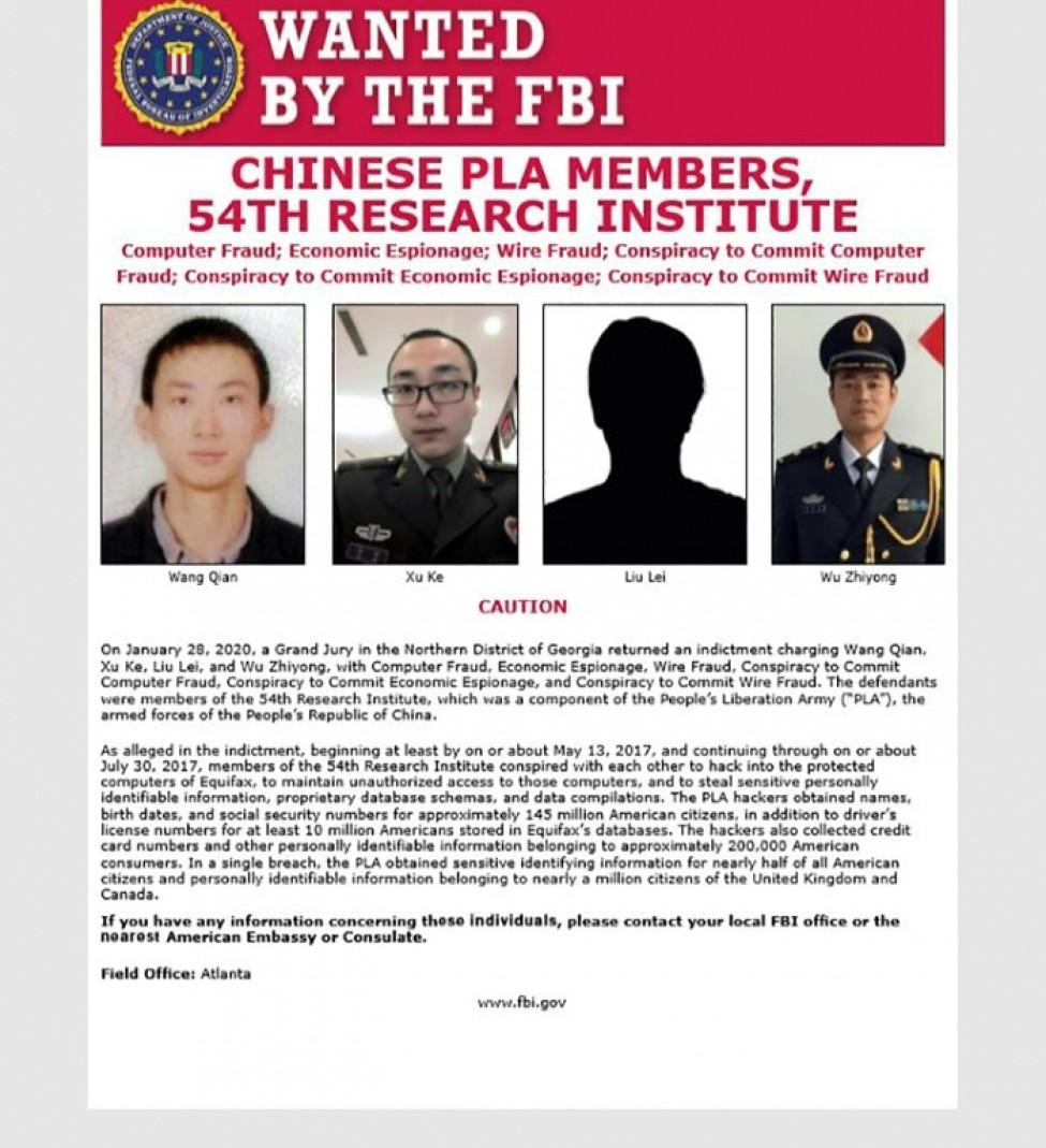 Une affiche de la police fédérale américaine concernant quatre agents chinois recherchés pour le piratage informatique de l\'agence de crédit Equifax, fournie à l\'AFP par le FBI le 10 février 2020