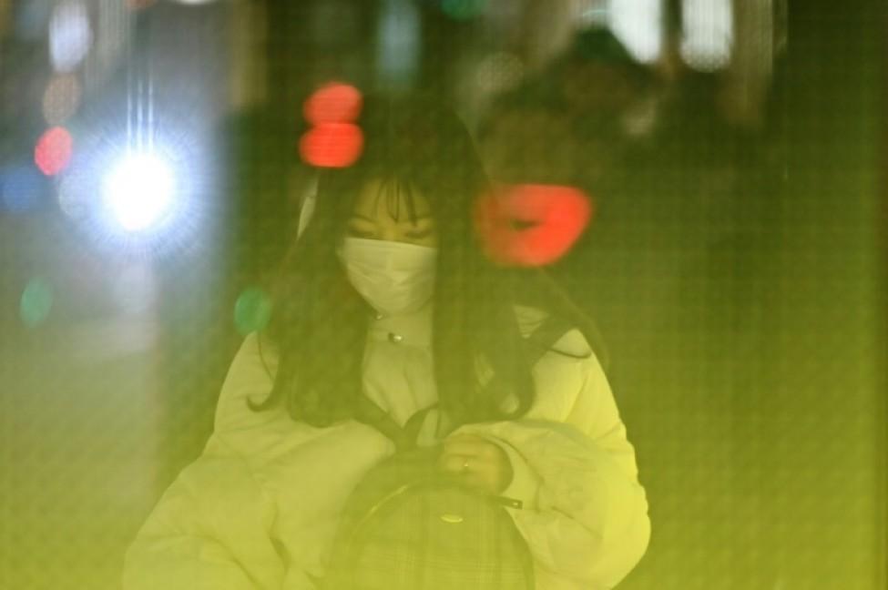 Une Japonaise dans le quartier de Ginza, à Tokyo, le 26 janvier 2020