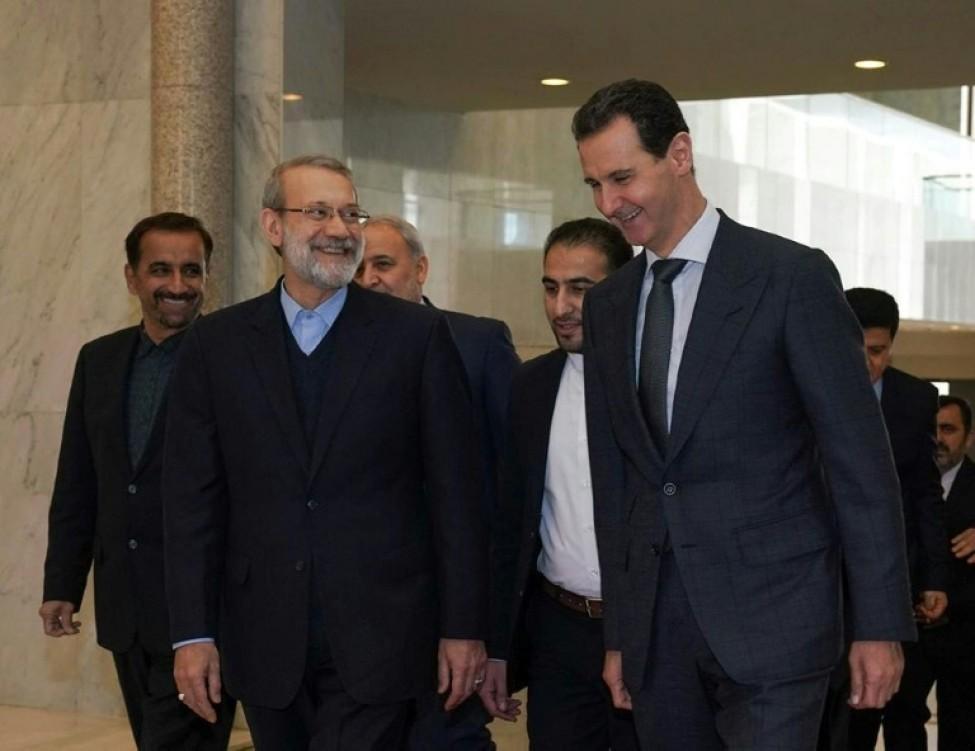 Une photo de la page Facebook officielle de la présidence syrienne, montre Bachar al-Assad et le président du Parlement iranien Ali Larijani, à Damas, le 16 février 2020