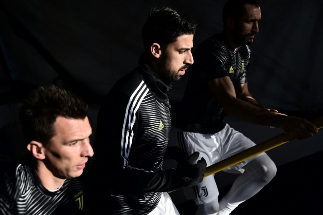Juventus midfielder Sami Khedira (C) has played just 15 matches this season because of injury.